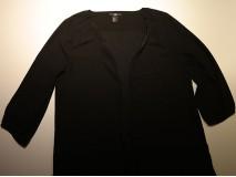 Van een bloes een los, open vestje maken met paspel.